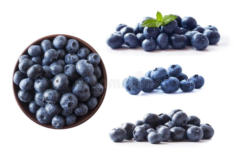 Blueberries in a wooden bowl. Ripe blueberries with copy space for text. Blueberry isolated on white. Bilberries  on a white backg. Round. Top view. Blueberries royalty free stock photography