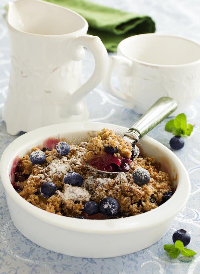 Blueberry and apple crumble. stock photos