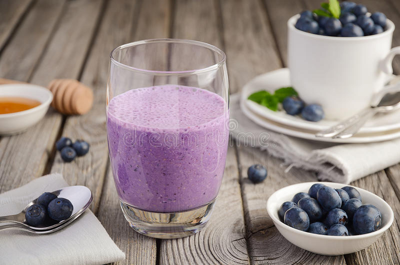 Blueberry and banana smoothie with oatmeal on rustic background stock photos