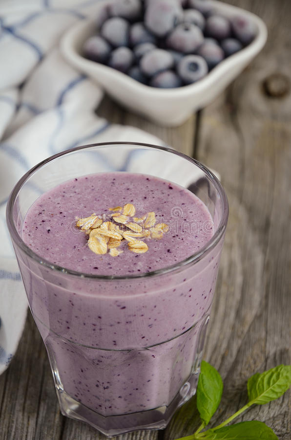 Blueberry and banana smoothie with oatmeal. stock image