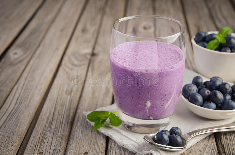 Blueberry and banana smoothie with oatmeal on the rustic wooden table stock photo