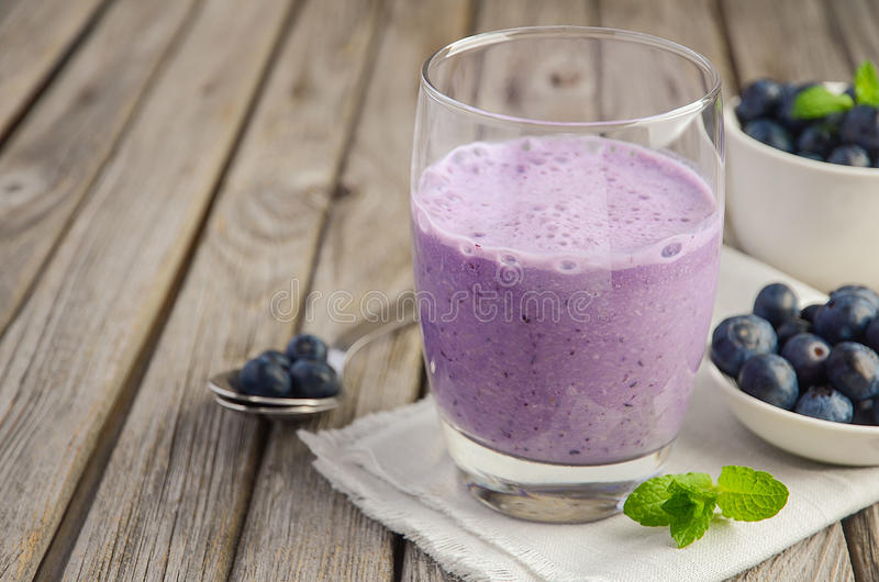 Blueberry and banana smoothie with oatmeal on rustic wooden table royalty free stock images