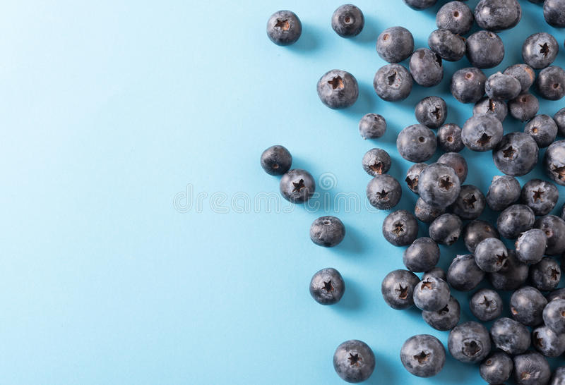 Blueberry border design. Ripe and juicy fresh picked bilberries close up. Copyspace for your text. royalty free stock photos