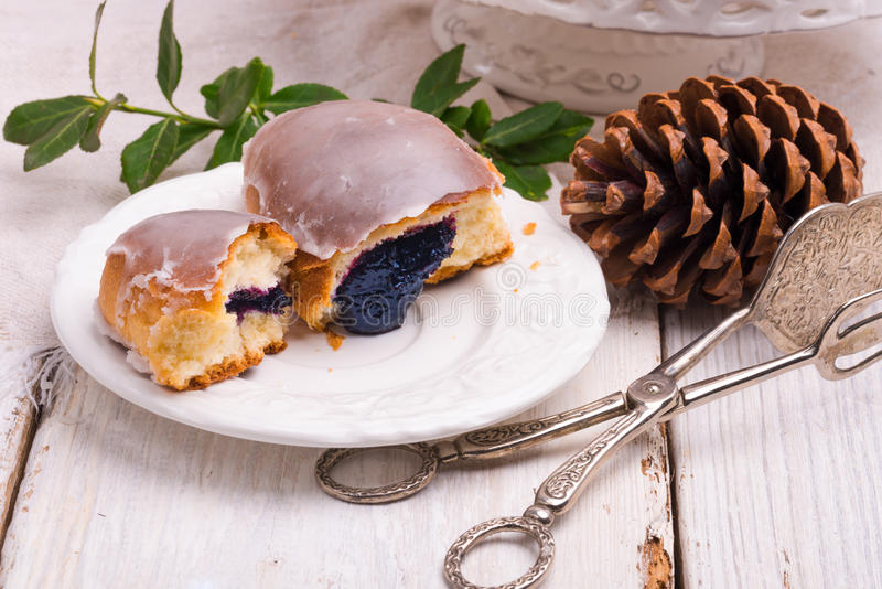 Blueberry bun. A fresh and tasty blueberry bun stock image