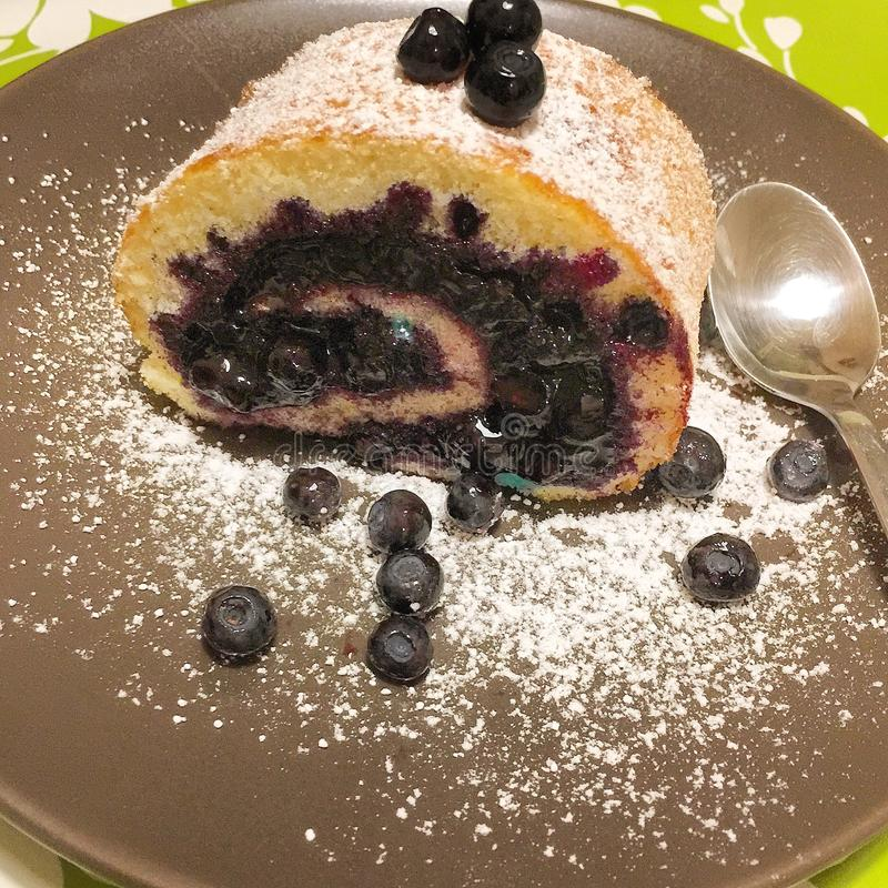 Blueberry cake-roll royalty free stock photo