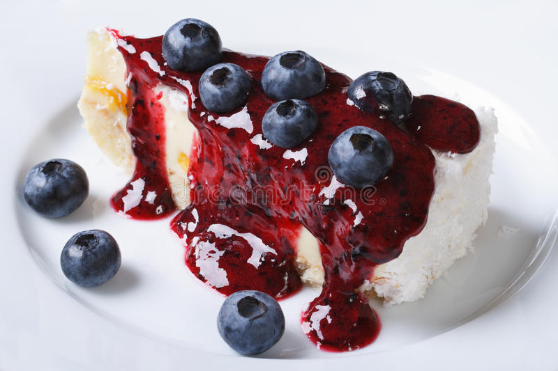 Blueberry cheesecake with berry sauce horizontal top view stock images