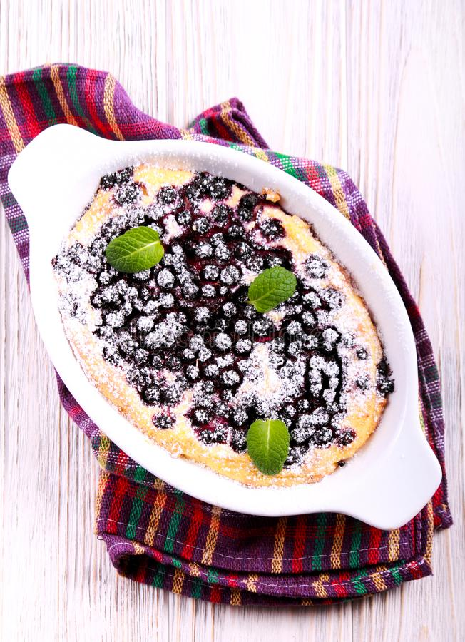 Blueberry cheesecake pudding in baking tin. Overhead stock image