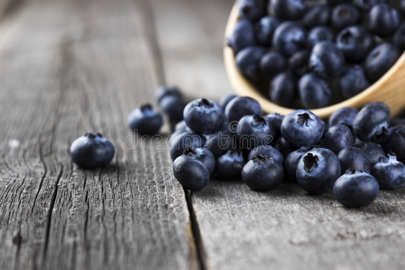 Blueberry on a dark wooden background royalty free stock images