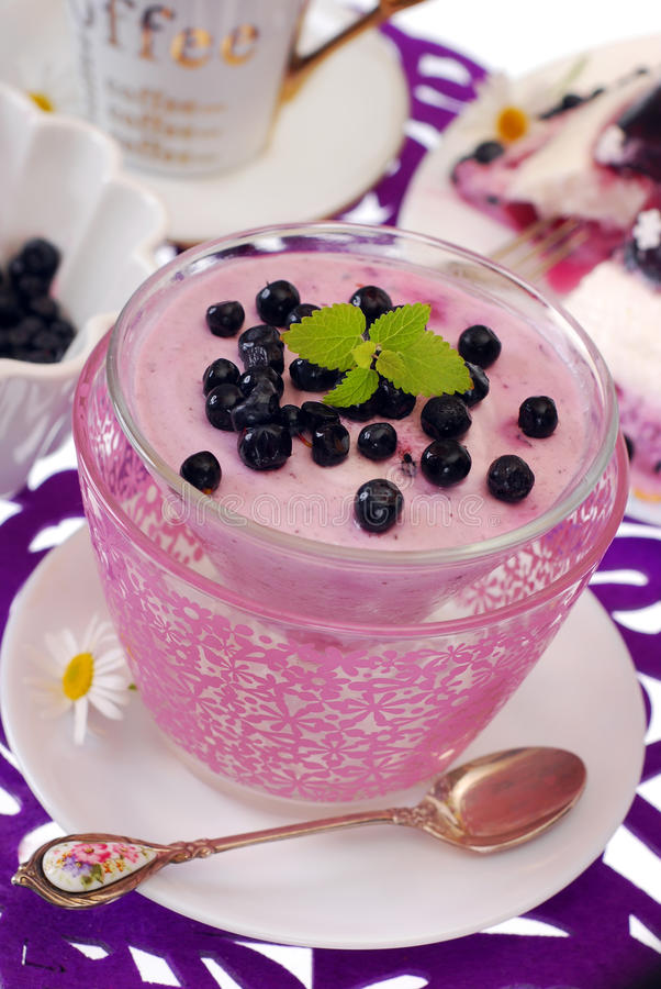 Blueberry dessert. Glass of blueberry dessert with yogurt and fresh fruits royalty free stock images
