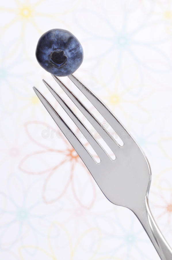 Blueberry On Fork Stock Photography