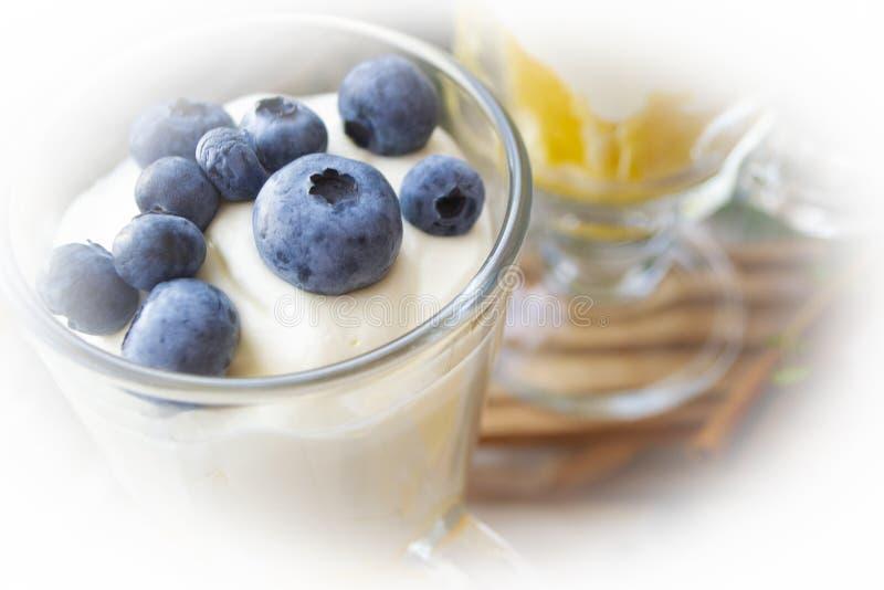 Blueberry greek yogurt in a glass, yogurt parfait with granola, close up. Blueberry greek yogurt in a glass, yogurt parfait with granola, closeup stock photos