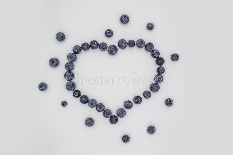 A Blueberry Heart. The heart`s frame from the berries. Beautiful blueberries making a heart frame.  royalty free stock image