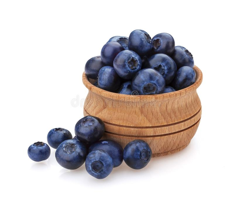 Blueberry isolated on white background. A pile of fresh blueberries in a wooden bowl royalty free stock photography