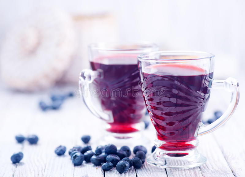 Blueberry juice. In glass and on a table stock image
