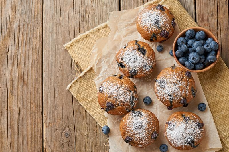 Blueberry muffin, top view, copy space. Cupcakes with berries on old rustic wooden table, breakfast with cake royalty free stock photos