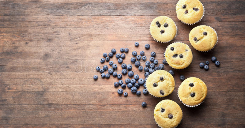 Blueberry Muffins Wood Background royalty free stock photo