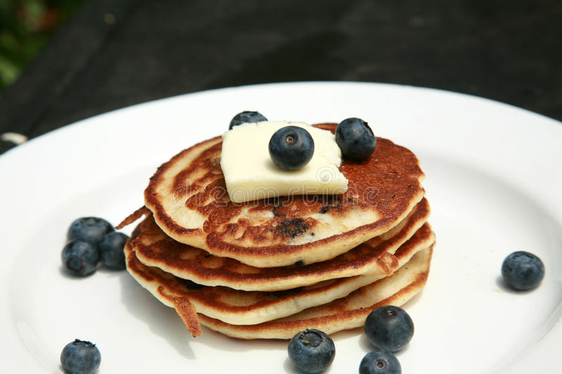 Blueberry pancakes for breakfast royalty free stock images