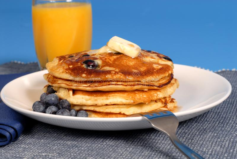 Blueberry pancakes with syrup royalty free stock photo