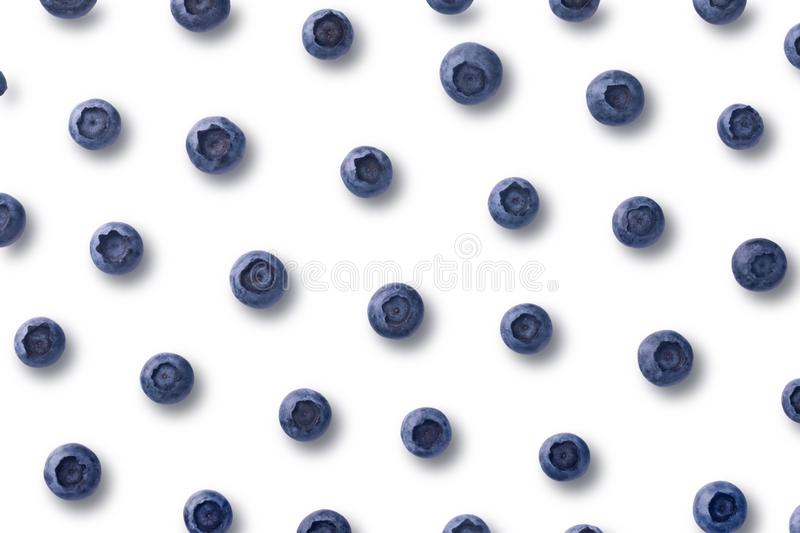 Blueberry pattern. Flatlay pattern with fresh ripe blueberries isolated on white background stock photo