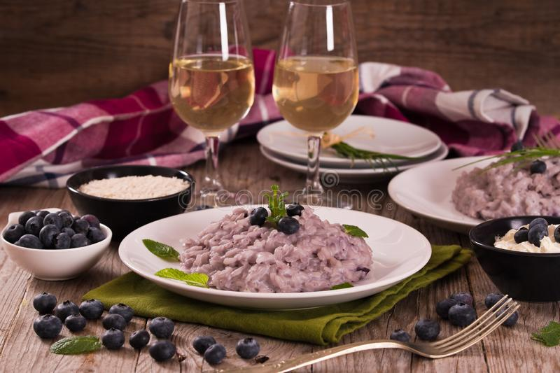 Blueberry risotto with mascarpone. stock photos