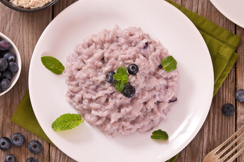 Blueberry risotto with mascarpone. stock photography