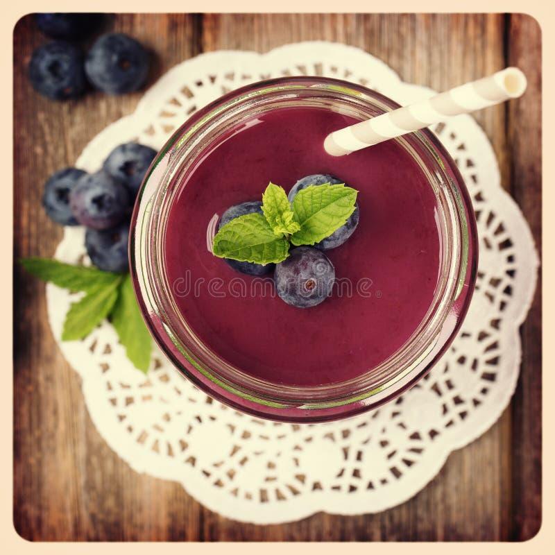 Blueberry smoothie retro style photo. stock photography
