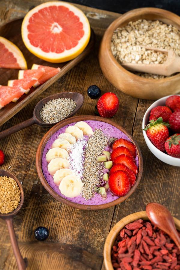 Blueberry smoothie and various superfoods stock image