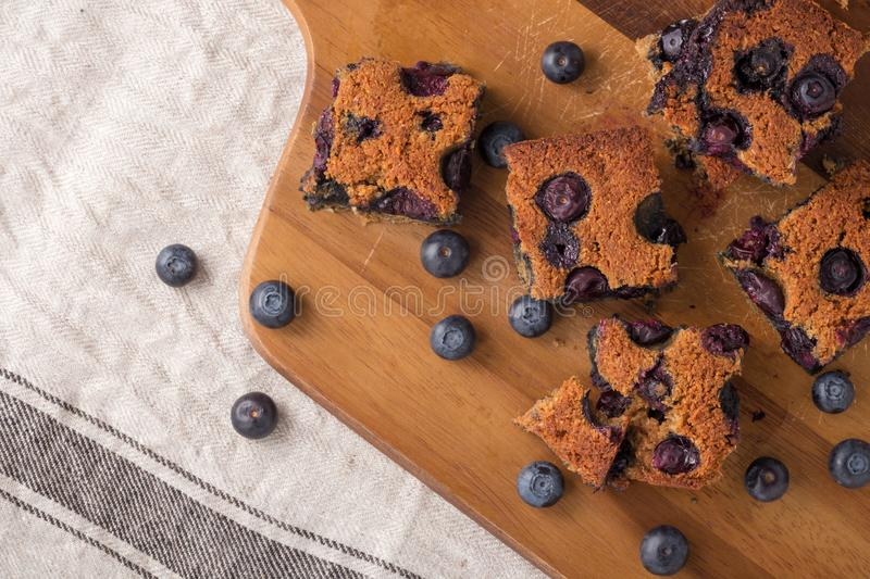 Blueberry square bars on wooden board with blueberries. Paleo low carb dessert stock image