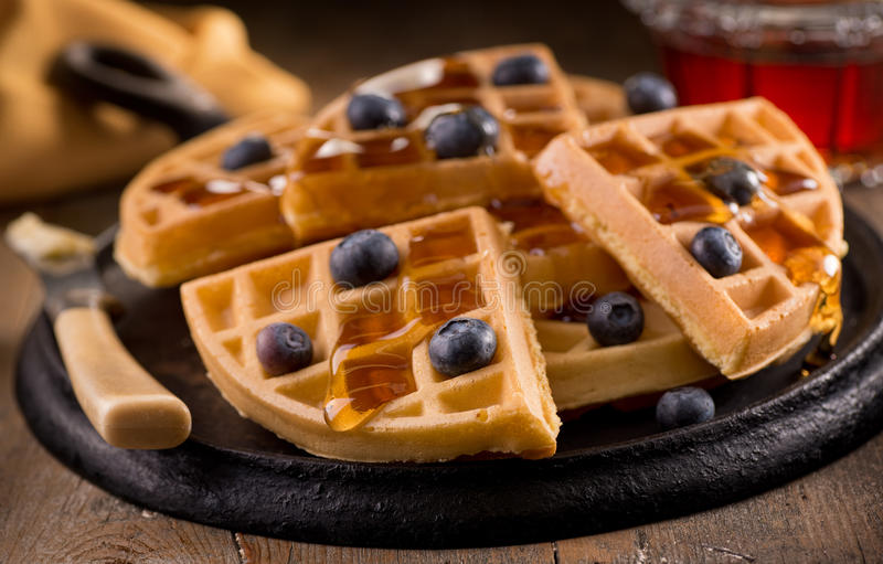 Blueberry Waffles. Delicious fresh homemade blueberry waffles with fresh blueberries and maple syrup stock image