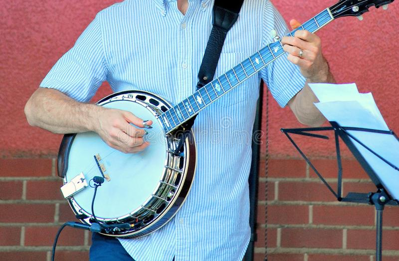 Bluegrass banjo player. Bluegrass male banjo player performing in concert outdoors royalty free stock photography