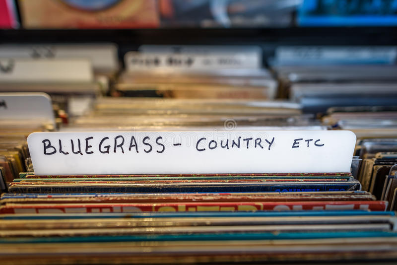 Bluegrass Records. A selection of Bluegrass and Country vinyl albums for sale in a second hand store royalty free stock image