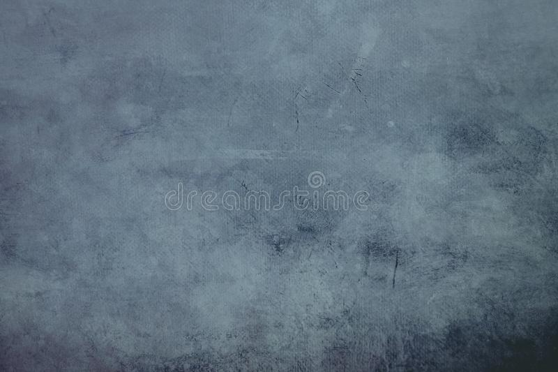 Blue grungy canvas background or texture with dark vignette borders. Pale blue abstract canvas background or texture with dark vignette borders stock images