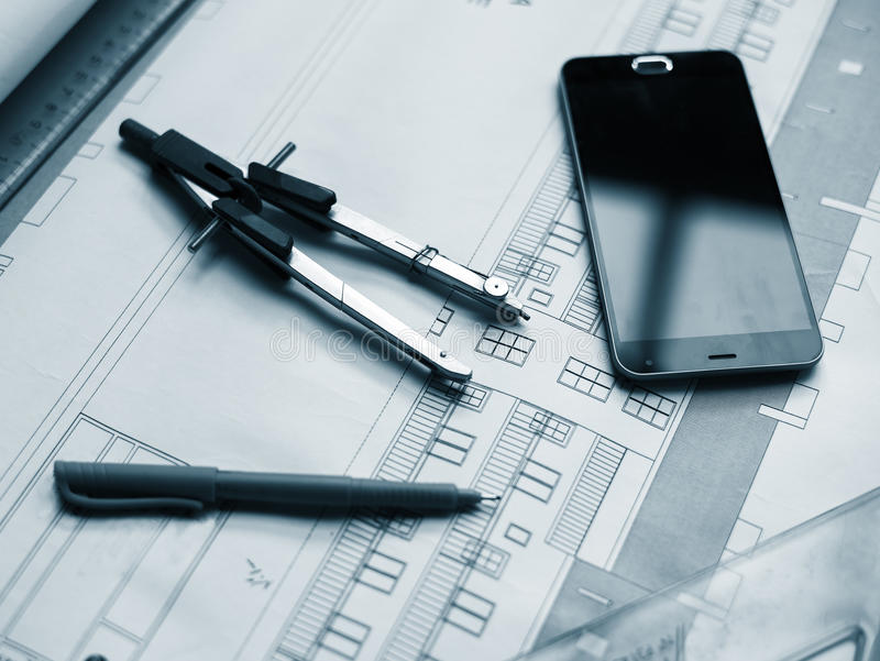 Blueprint. Architectural project, rulers, cell phone and pen stock photo