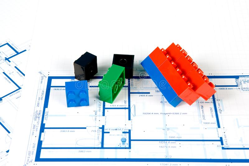 Blueprint for a house and plastic blocks royalty free stock photography