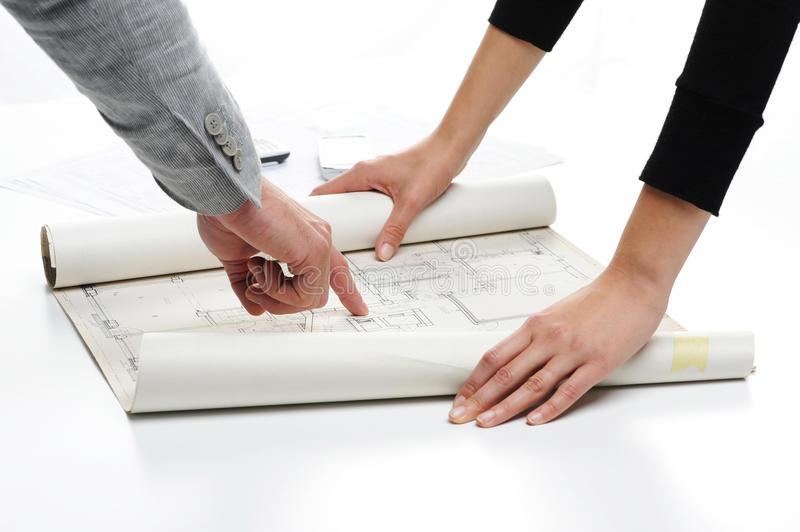 Blueprint of new house project. Architects hands pointing on the blueprint of new house project stock photos