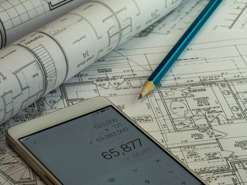 Blueprint o plano da construção civil da casa com lápis e Ca fotografia de stock