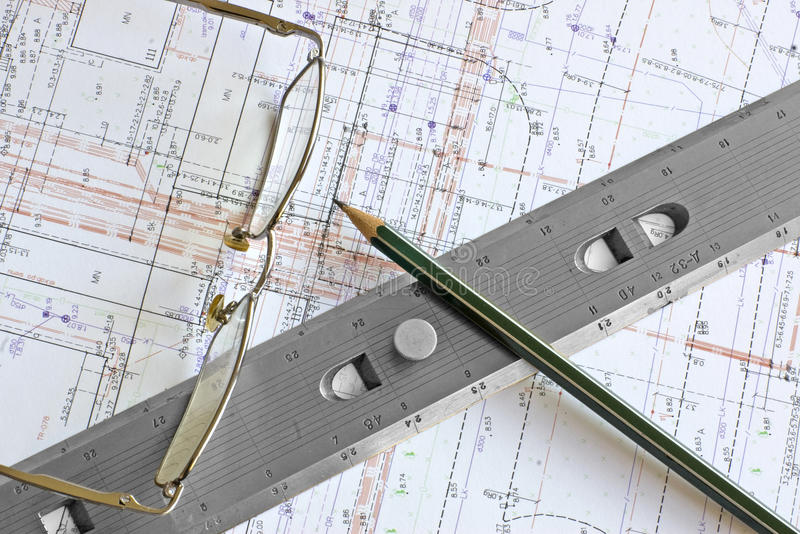 Blueprint with pencil, glasses and ruler royalty free stock photo