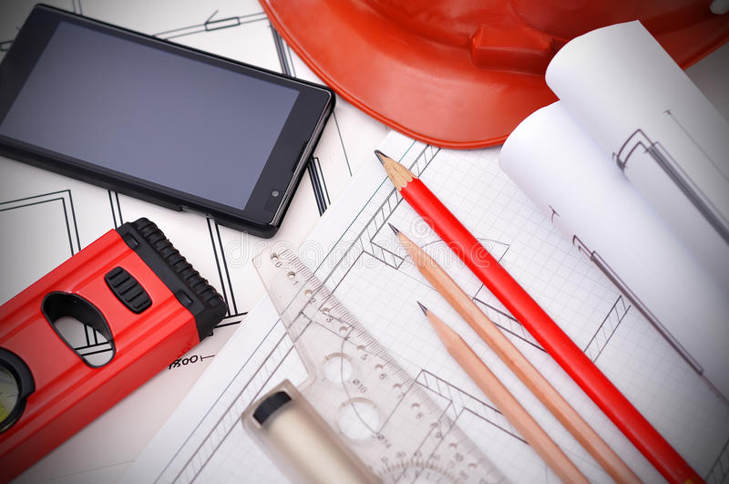 Blueprint, phone and tools royalty free stock images
