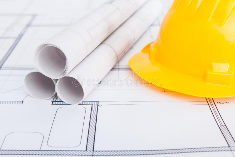 blueprints hardhat стоковое фото rf