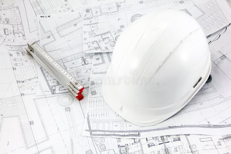 Blueprints helmet and meter stock photos