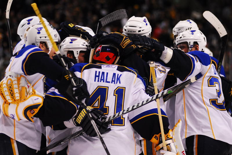 Blues celebrate a shootout win in Boston. Members of the St. Louis Blues congratulate Juroslave Halak after beating the Boston Bruins in a shootout on Thursday royalty free stock photography