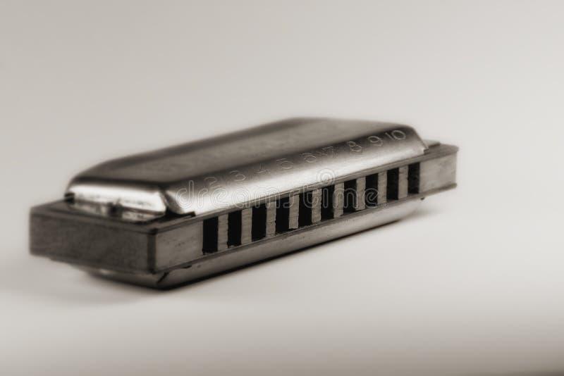 Blues harmonica. Close up of blues harmonica , shallow DOF retro style toned photo royalty free stock photo