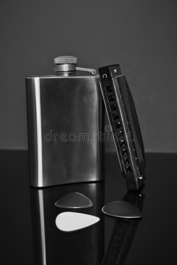 Blues harp, picks and hip flask royalty free stock photography