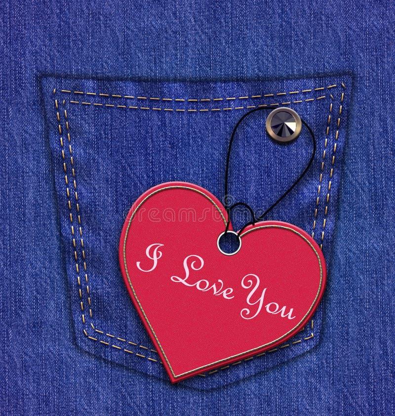 Blues-jean avec le label de forme de coeur image libre de droits