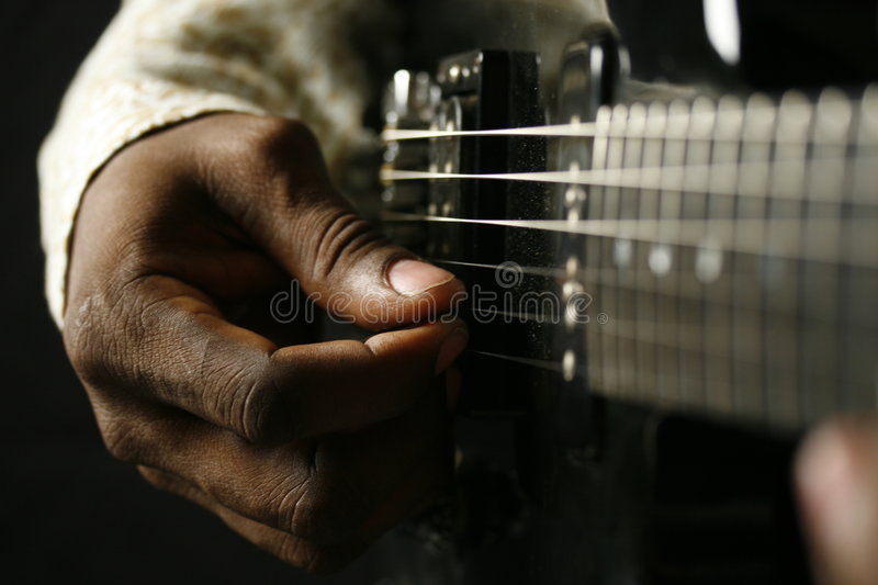 Blues Man. Right Hand of a Blues Man playing the Guitar