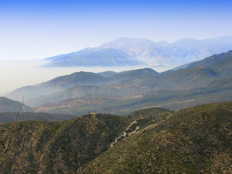 Blues sky over mountains stock images