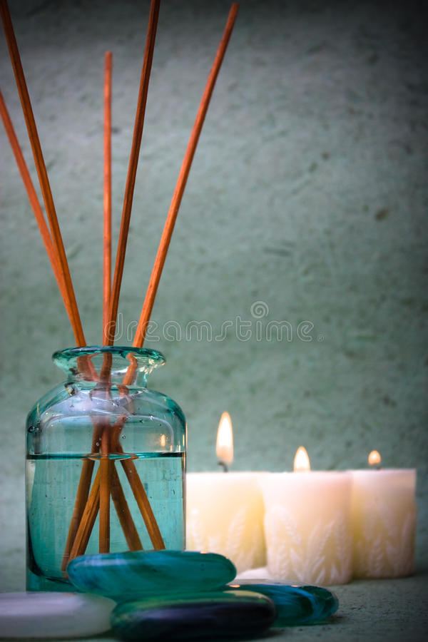 Blues spa. Spa oil with candles and stones royalty free stock photos