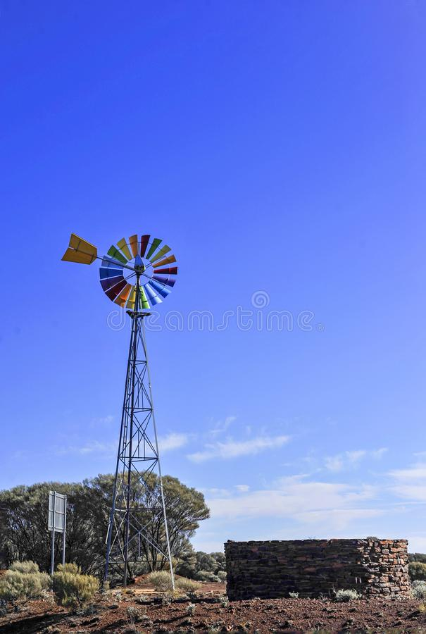 Windmill with multi coloured blades, very popular with tourists with cameras. stock images