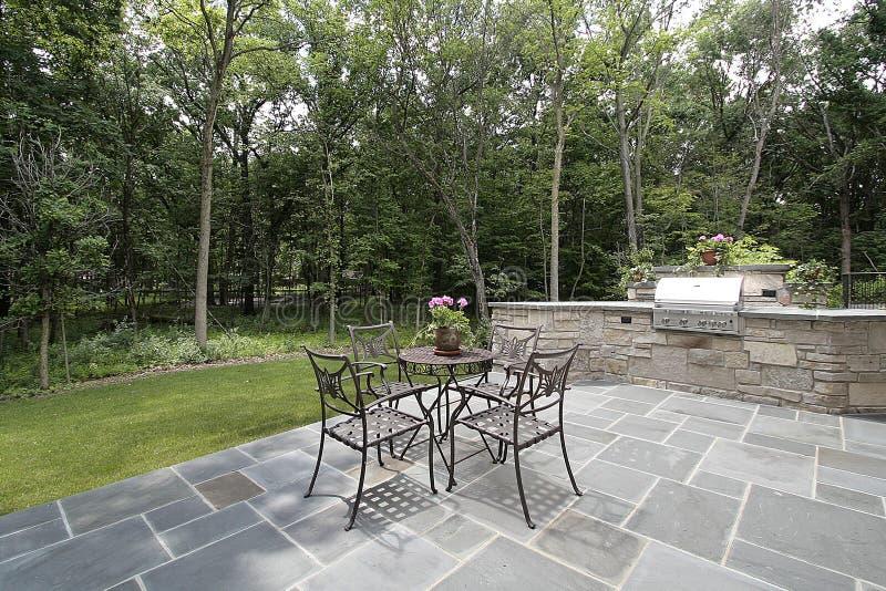 Bluestone patio and stone grill stock photo