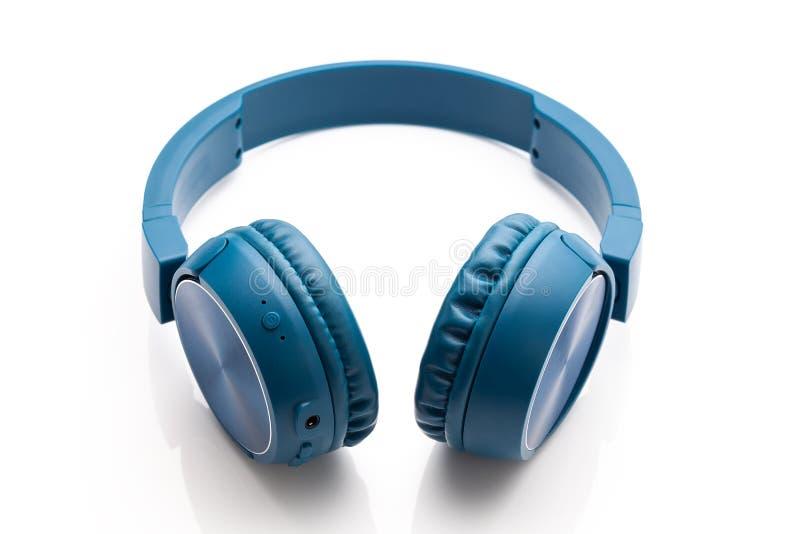 Bluetooth blue headphone on white background. Studio packshot equipment stock image